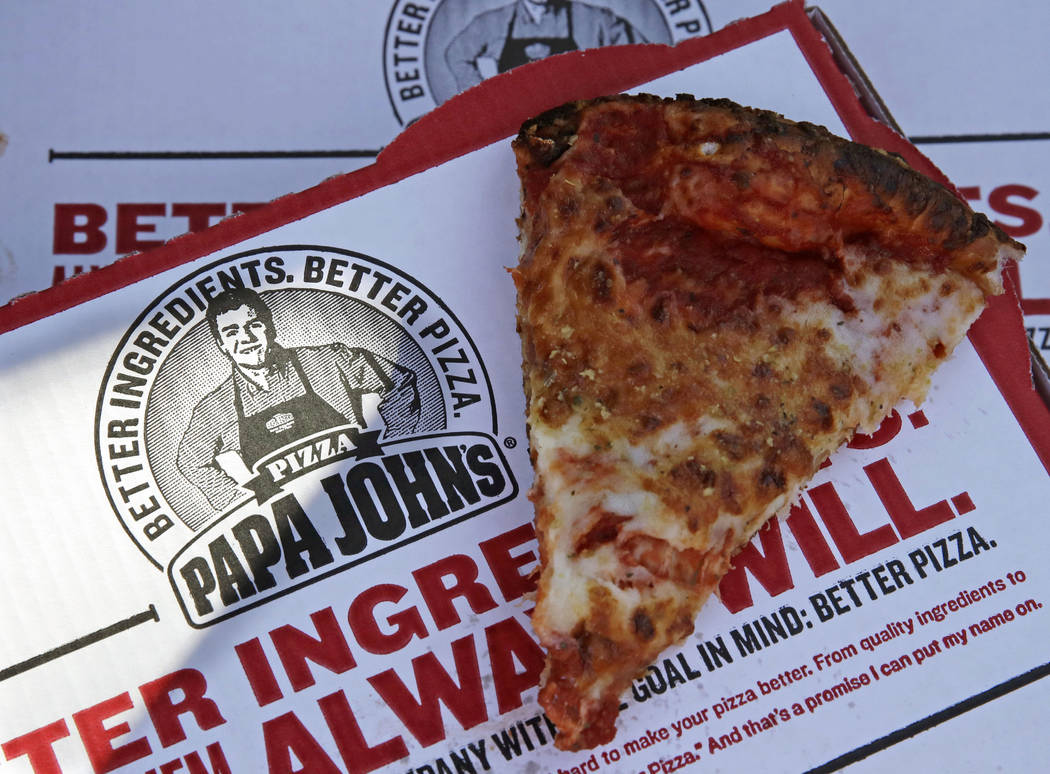 A slice of cheese pizza at the Papa John's pizza shop in Quincy, Mass. on Dec. 21, 2017. (AP Photo/Charles Krupa, File)