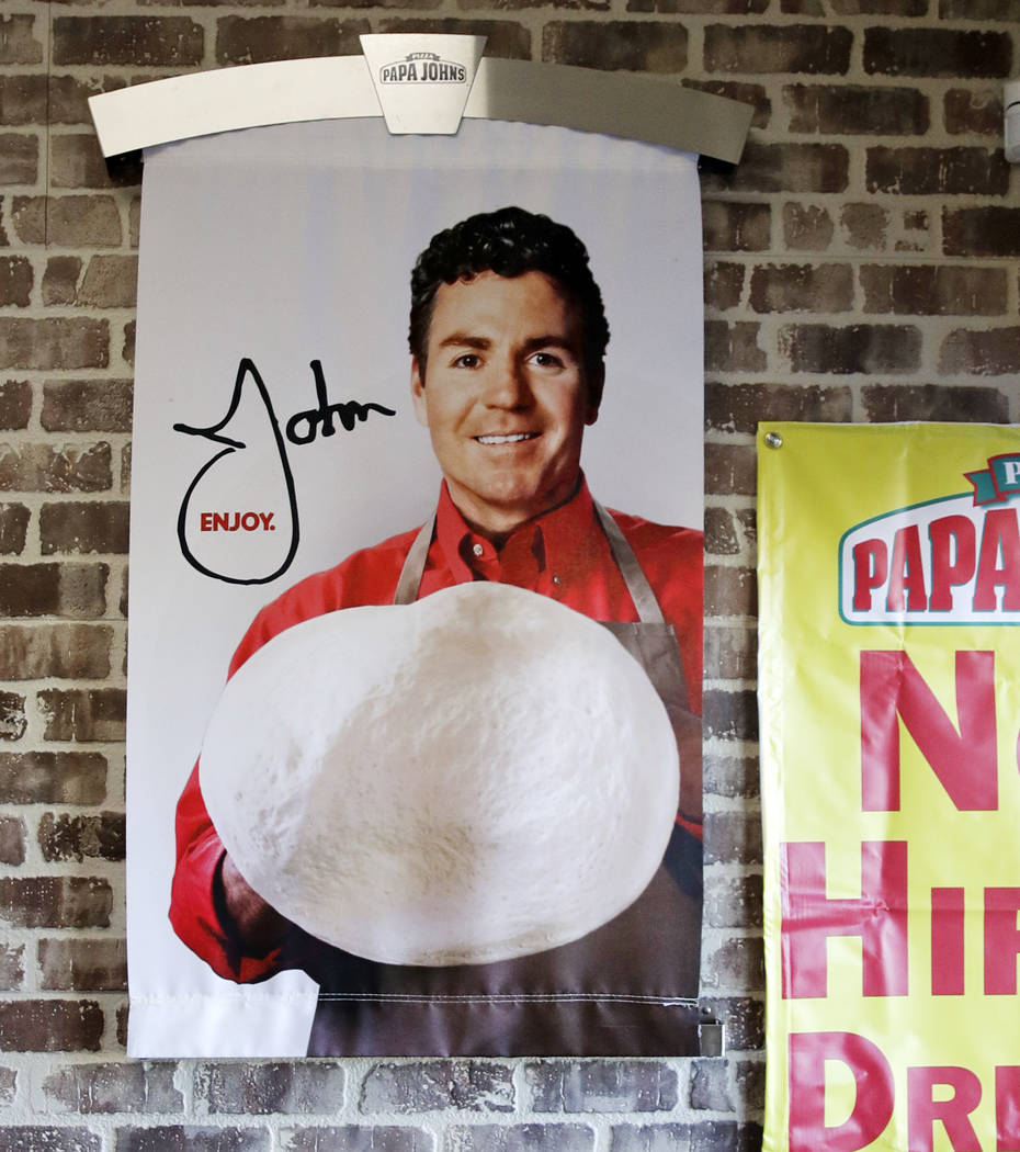 Signs, including one featuring Papa John's founder John Schnatter, at a Papa John's pizza store in Quincy, Mass. on Dec. 21, 2017. (AP Photo/Charles Krupa, File)