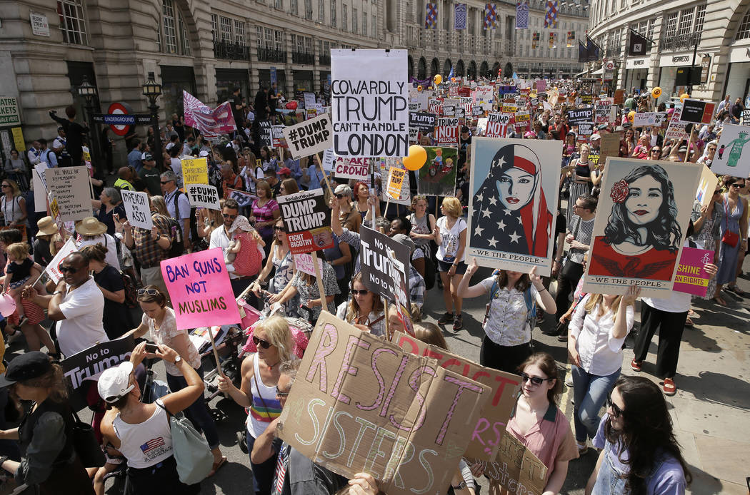 "Protestors hold banners during the ""Stop Trump"" Women's March in London, Friday, July 13, 2018. U.S. President Donald Trump's pomp-filled welcome to Britain was overshadowed Friday by an explosive ..."