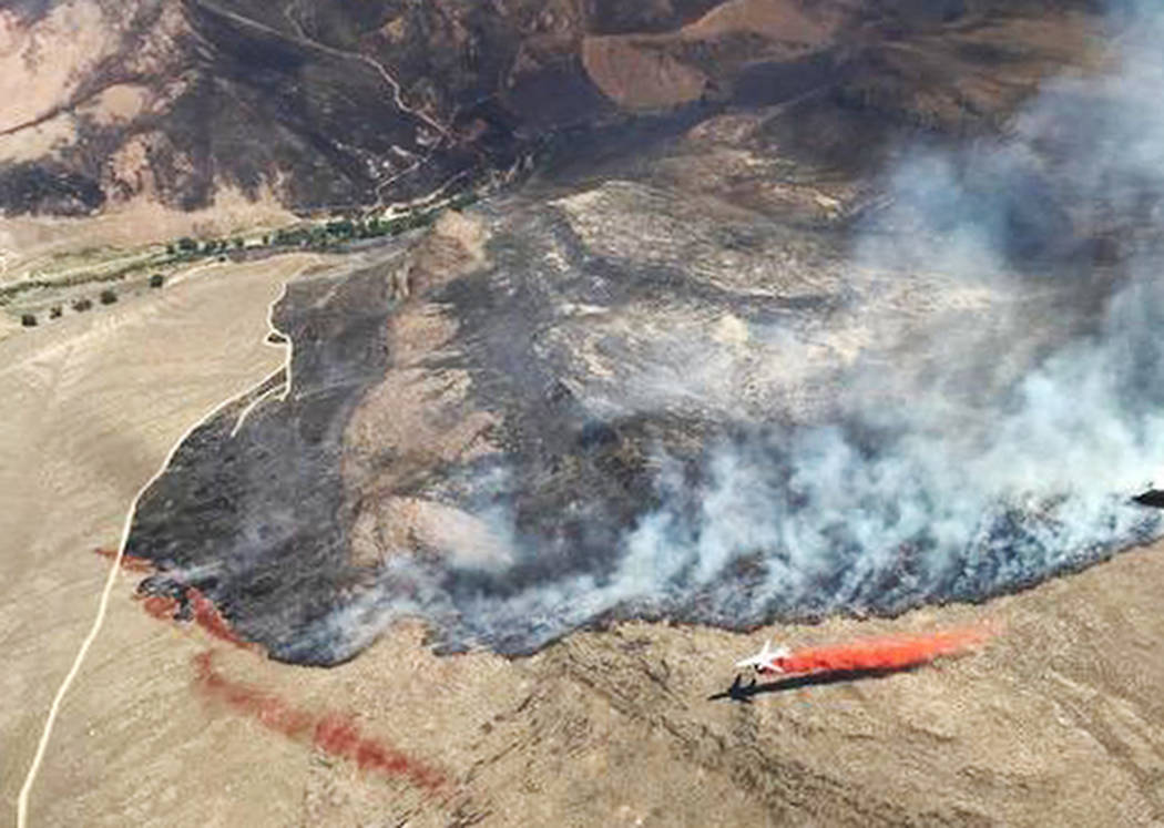 An aircraft drops fire retardant on the Martin Fire in northern Nevada on July 7 2018. (Bureau of Land Management)
