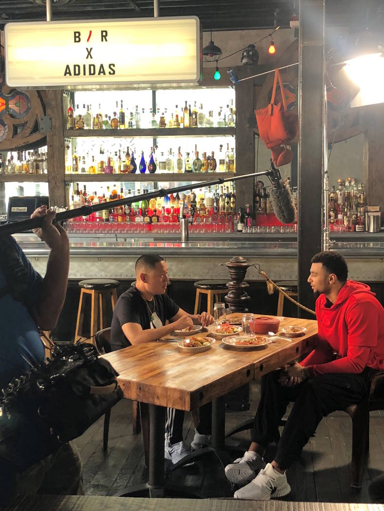 Jamal Murray of the Denver Nuggets and Eddie Huang of the Bleacher Report record video at La Comida on Fremont East on Monday, July 9, 2018. (Wicked Creative)