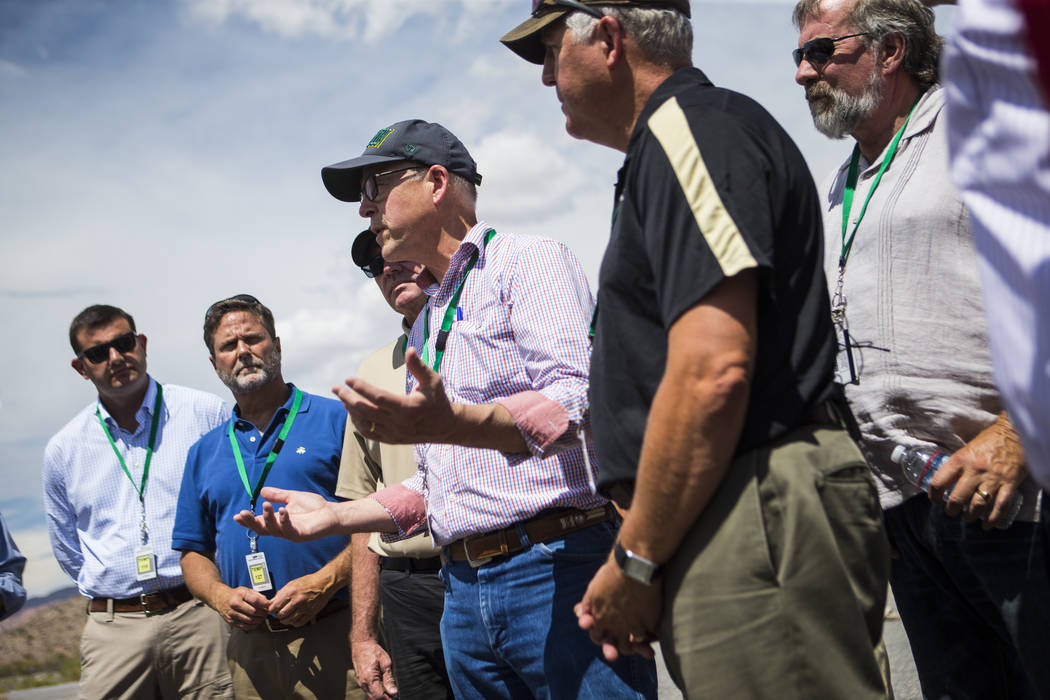 U.S. Rep. Greg Walden, R-Ore., center, speaks during a congressional tour of Yucca Mountain near Mercury on Saturday, July 14, 2018. Chase Stevens Las Vegas Review-Journal @csstevensphoto