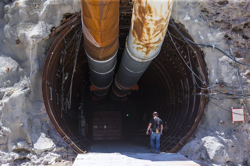 A contractor walks into the south portal of Yucca Mountain during a congressional tour near Mercury on Saturday, July 14, 2018. Chase Stevens Las Vegas Review-Journal @csstevensphoto