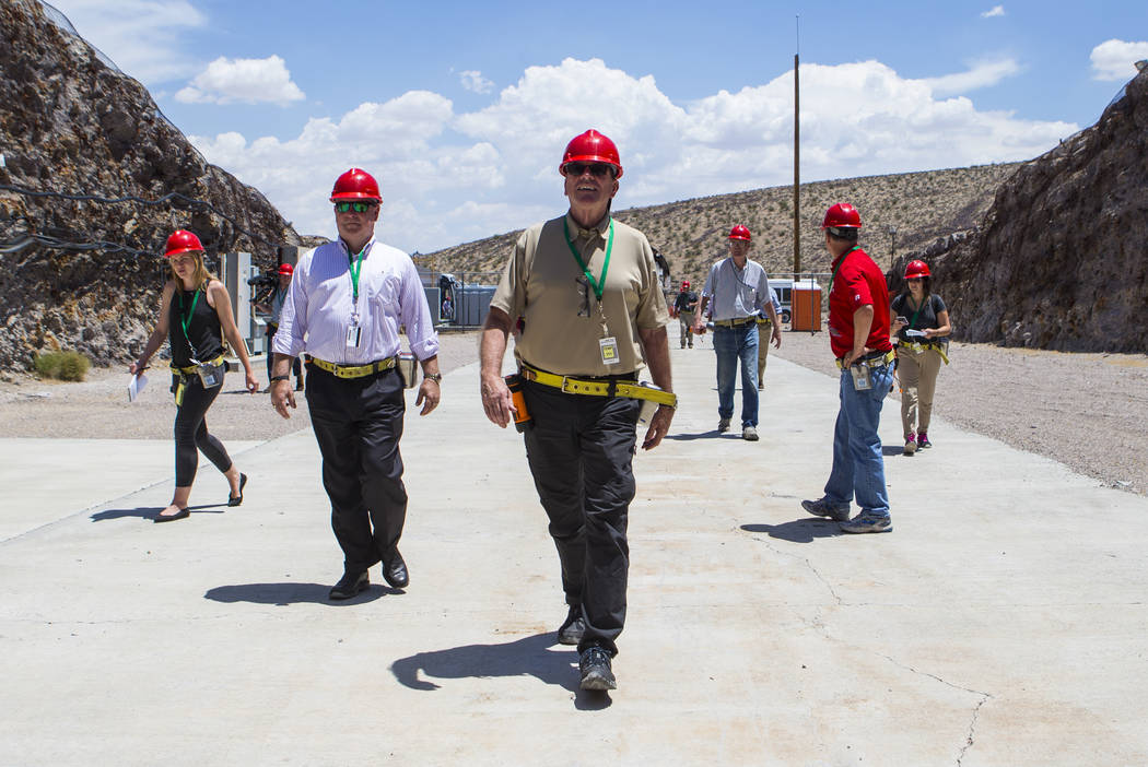 U.S. Rep. Neal Dunn, R-Fla., center, heads to the south portal of Yucca Mountain during a congressional tour near Mercury on Saturday, July 14, 2018. Chase Stevens Las Vegas Review-Journal @csstev ...
