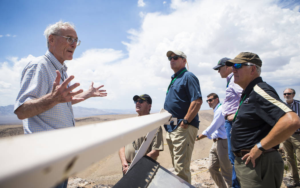 Wiilliam Boyle of the Department of Energy's Office of Nuclear Energy, left, speaks at the crest of Yucca Mountain during a congressional tour near Mercury on Saturday, July 14, 2018. Chase Steven ...