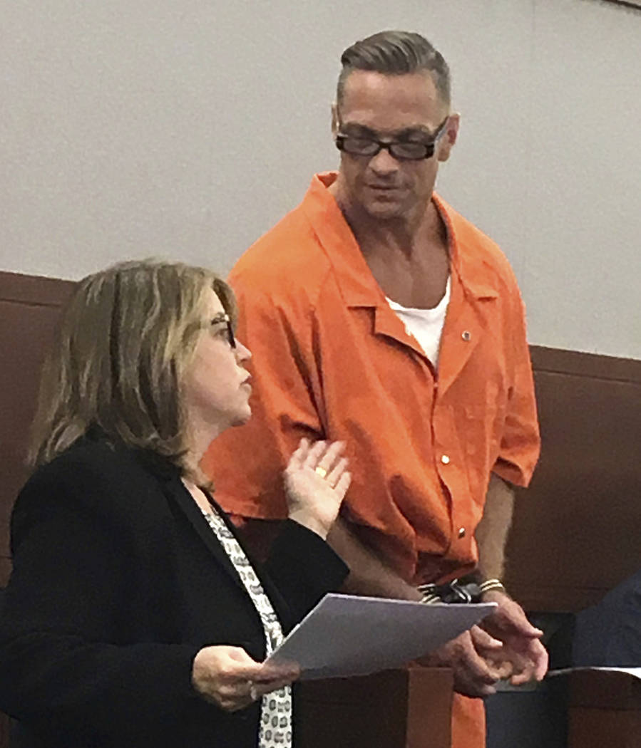 FILE - In this Aug. 17, 2017 file photo, Nevada death row inmate Scott Raymond Dozier confers with Lori Teicher, a federal public defender involved in his case, during an appearance in Clark Count ...