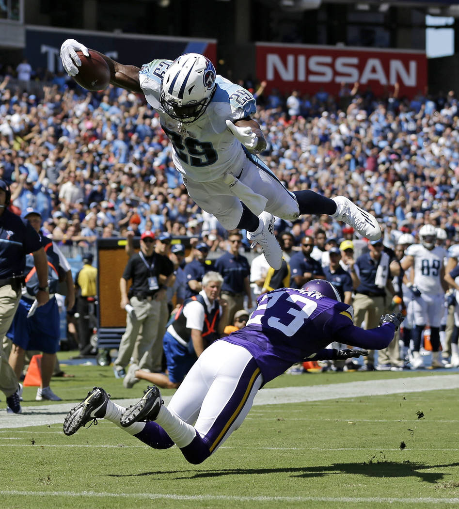 In this Sept. 11, 2016, file photo, Tennessee Titans running back DeMarco Murray (29) dives over Minnesota Vikings cornerback Terence Newman (23) to score a touchdown on a 6-yard pass reception in ...