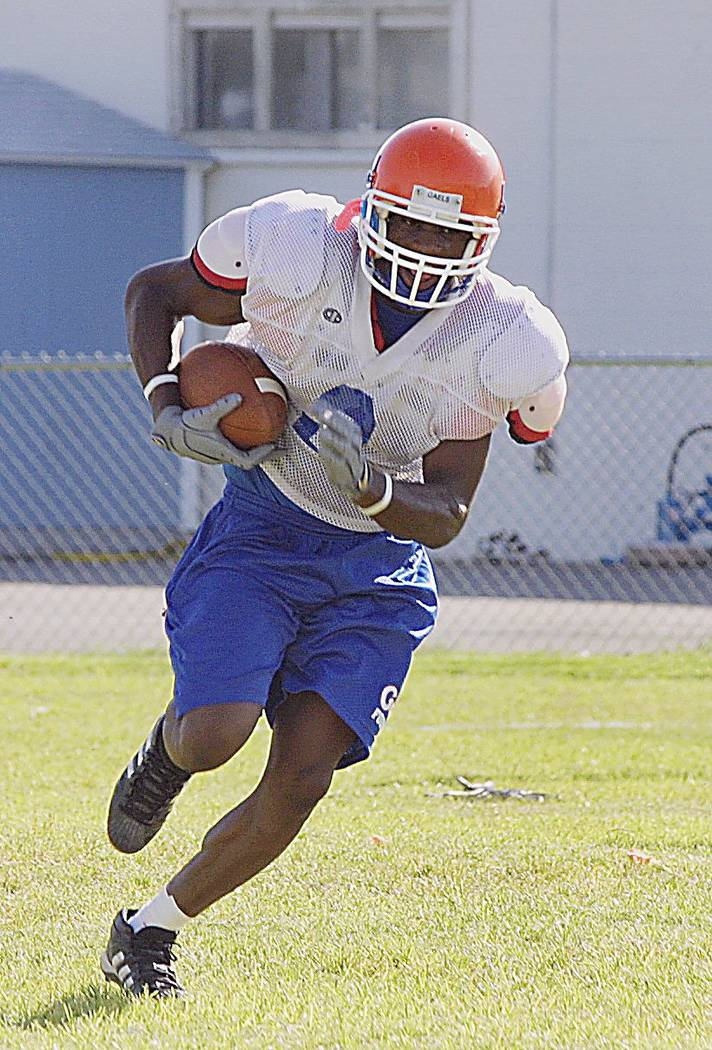 Demarco Murray with Bishop Gorman High School Football team runs down field at Pratice Thursday Aug. 19, 2004. View photo by Henry Vargas. Henry Vargas