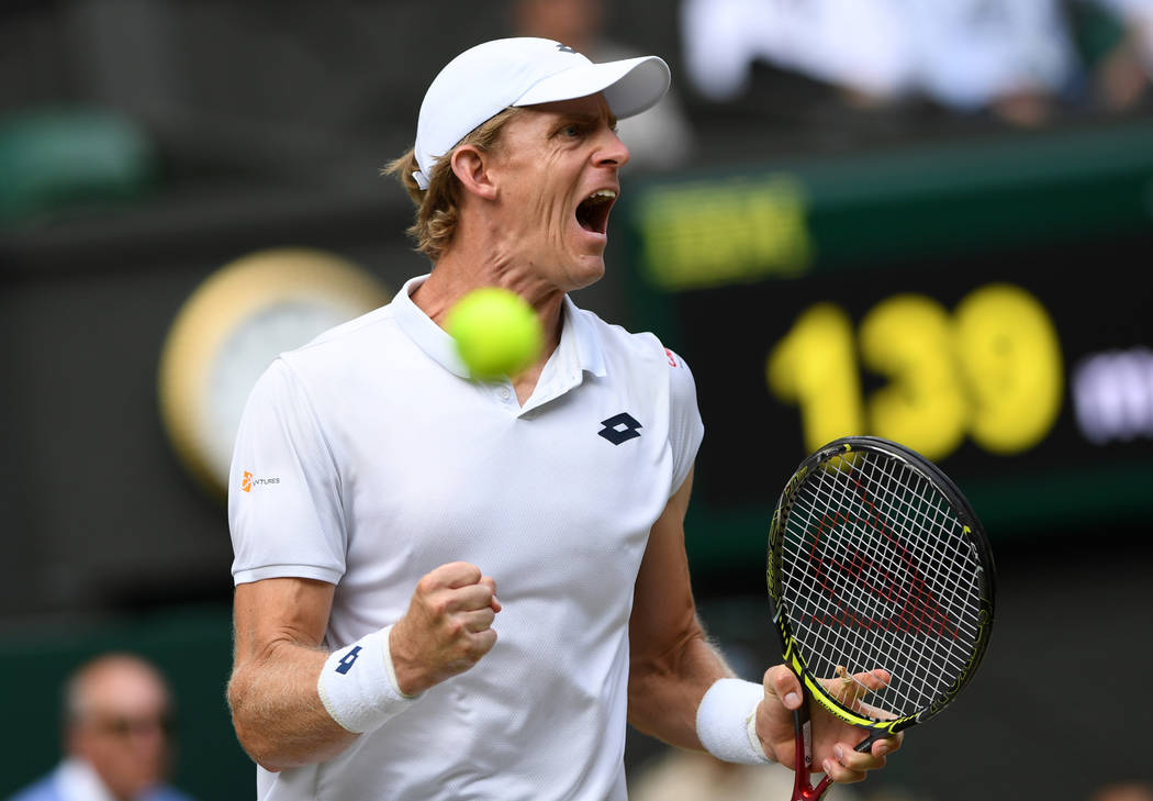 Kevin Anderson of South Africa celebrates winning a point from John Isner of the US during their men's singles semifinal match at the Wimbledon Tennis Championships, in London, Friday July 13, 201 ...