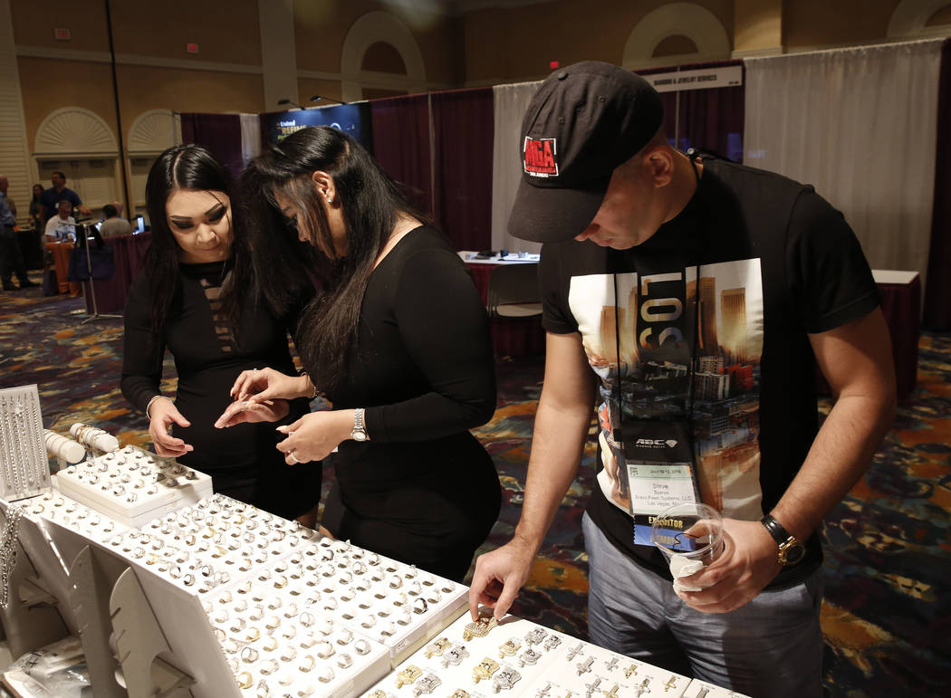 Attendees, including Ashlyn Nakagawa, left, and Tracy Lopez, center check out jewelries at Pawn Expo at the Mirage hotel-casino on Thursday, July 12, 2018, in Las Vegas. Bizuayehu Tesfaye/Las Vega ...