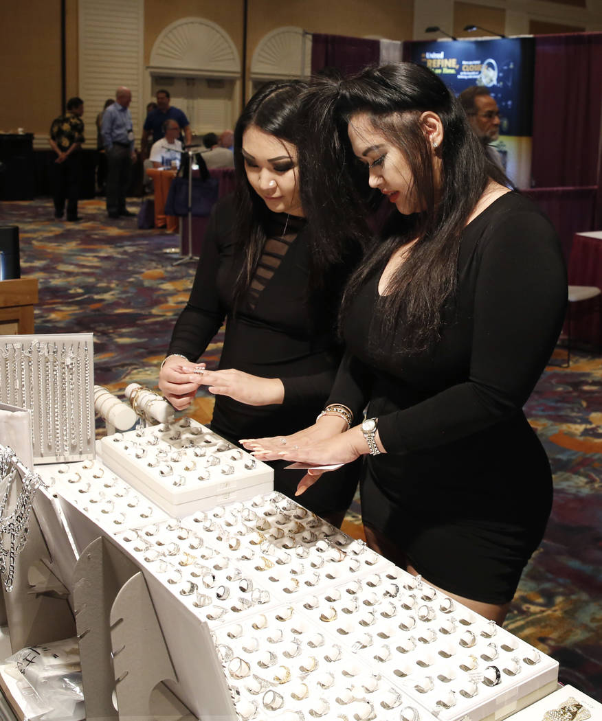 Ashlyn Nakagawa, left, and Tracy Lopez try out rings at Pawn Expo at the Mirage hotel-casino on Thursday, July 12, 2018, in Las Vegas. Bizuayehu Tesfaye/Las Vegas Review-Journal @bizutesfaye