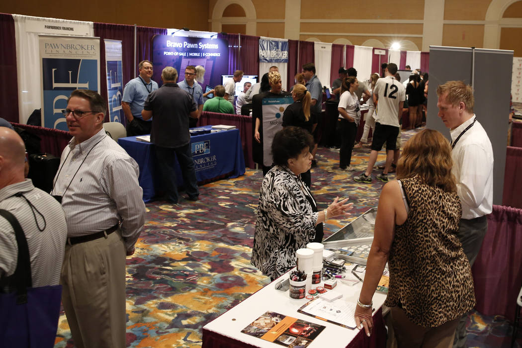 Attendees check out items at Pawn Expo at the Mirage hotel-casino on Thursday, July 12, 2018, in Las Vegas. Bizuayehu Tesfaye/Las Vegas Review-Journal @bizutesfaye