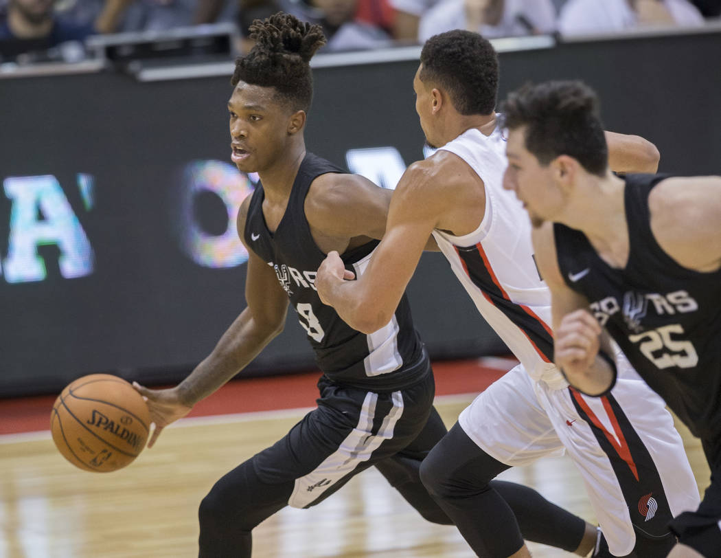 San Antonio Spurs guard Lonnie Walker (18) drives past Portland Trail Blazers Wade Baldwin IV (2) in the 2nd quarter during the NBA Summer League on Tuesday, July 10, 2018, at Cox Pavilion, in Las ...
