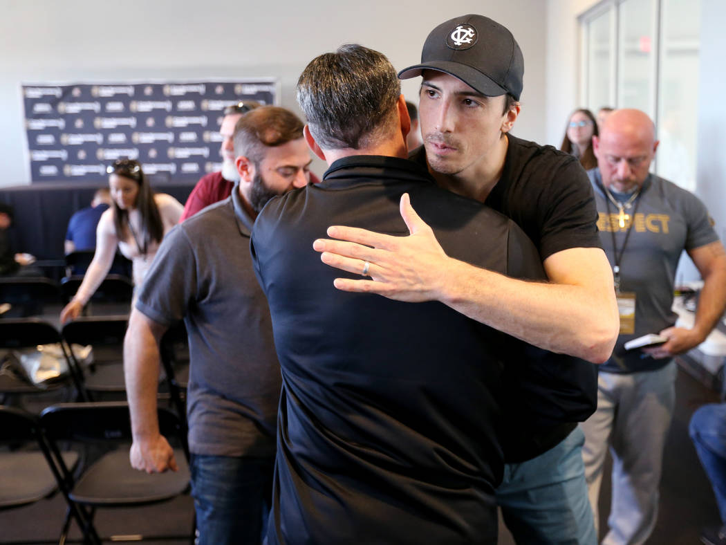 Golden Knights goalie Marc-Andre Fleury hugs team's TV play-by-play announcer Dave Goucher after talking to the news media at City National Arena Friday, June 8, 2018, after ending their season Th ...