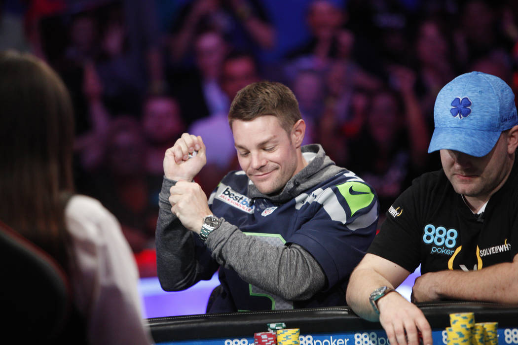 Tony Miles does a little dance after a good play on the eighth day of the World Series of Poker tournament at the Rio Convention Center in Las Vegas, Thursday, July 12, 2018. Artem Metalidi and Al ...