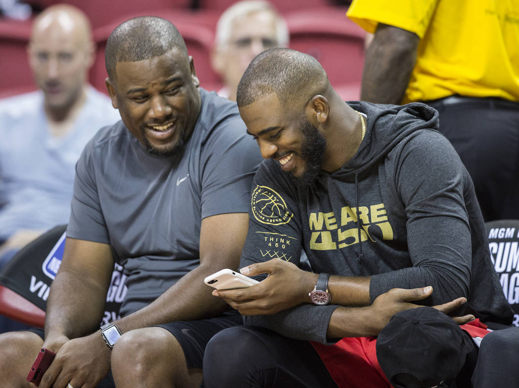 Houston Rockets point guard Chris Paul, right, shares a laugh with a friend at the Thomas & Mack Center during the NBA Summer League on Tuesday, July 10, 2018, in Las Vegas. Benjamin Hager Las ...