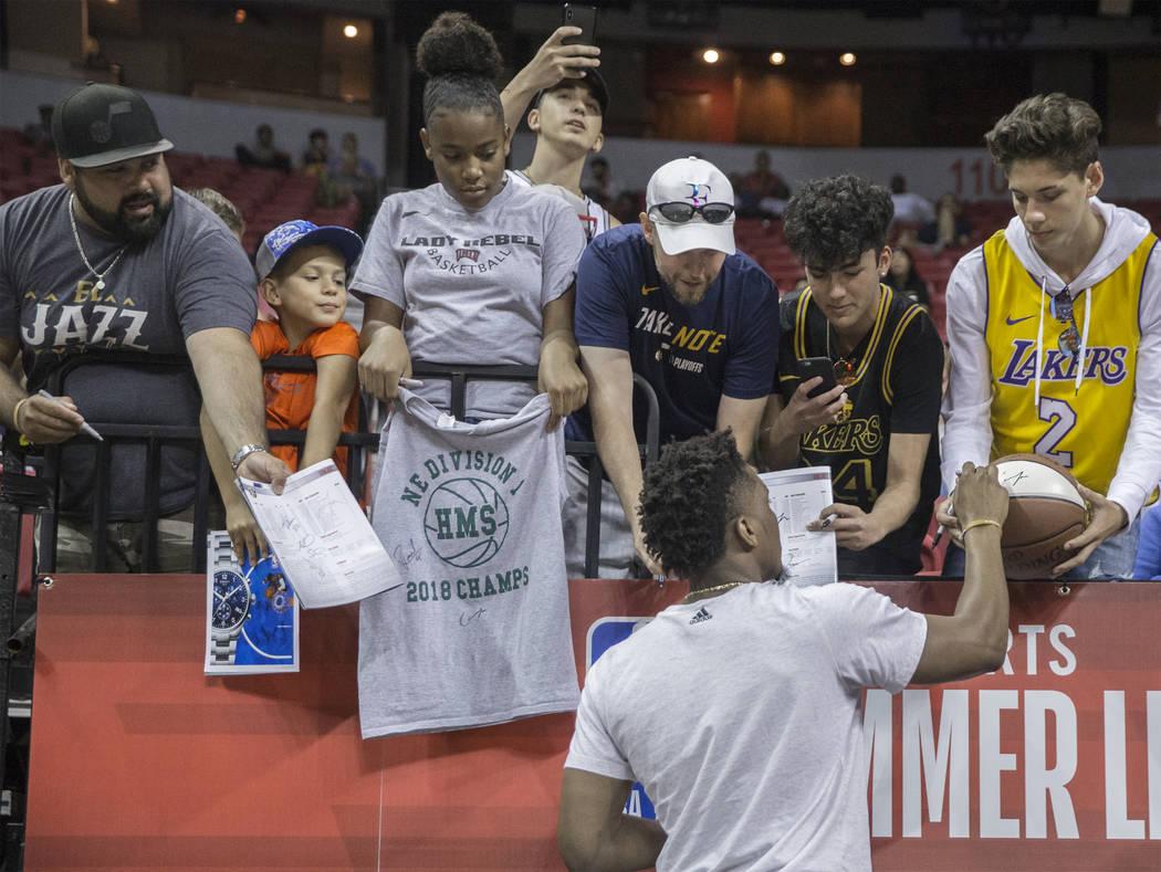 Utah Jazz star Donovan Mitchell signs autographs at the Thomas & Mack Center during the NBA Summer League on Tuesday, July 10, 2018, in Las Vegas. Benjamin Hager Las Vegas Review-Journal @benj ...