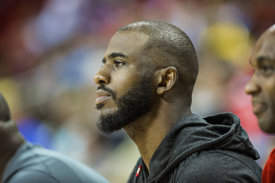Houston Rockets point guard Chris Paul watches the Los Angeles Lakers play the New York Knicks during the NBA Summer League on Tuesday, July 10, 2018, at the Thomas & Mack Center, in Las Vega ...