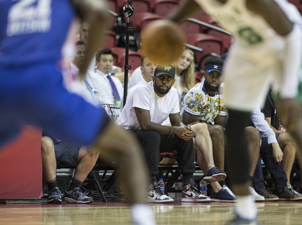 Celtics star point guard Kyrie Irving, middle, watches Boston play the New York Knicks during the NBA Summer League on Thursday, July 12, 2018, at the Thomas & Mack Center, in Las Vegas. Benja ...