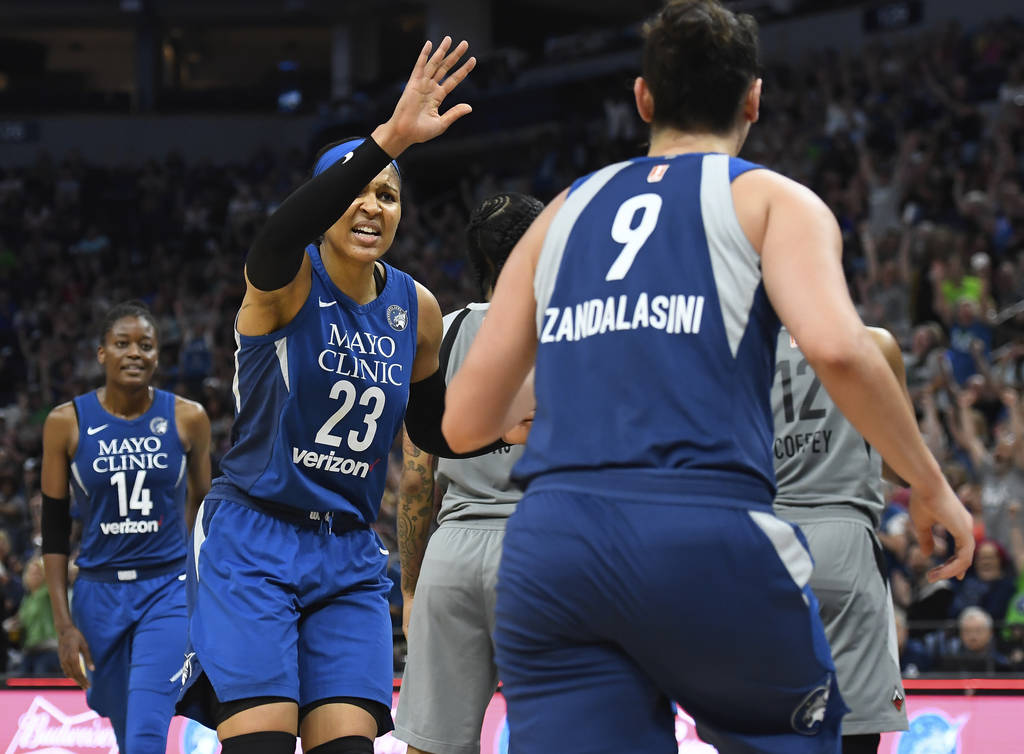 Minnesota Lynx forward Maya Moore (23) celebrates with forward Cecilia Zandalasini (9) after Zandalasini hit a 2-point buzzer-beater to end the first quarter against the Las Vegas Aces during a WN ...