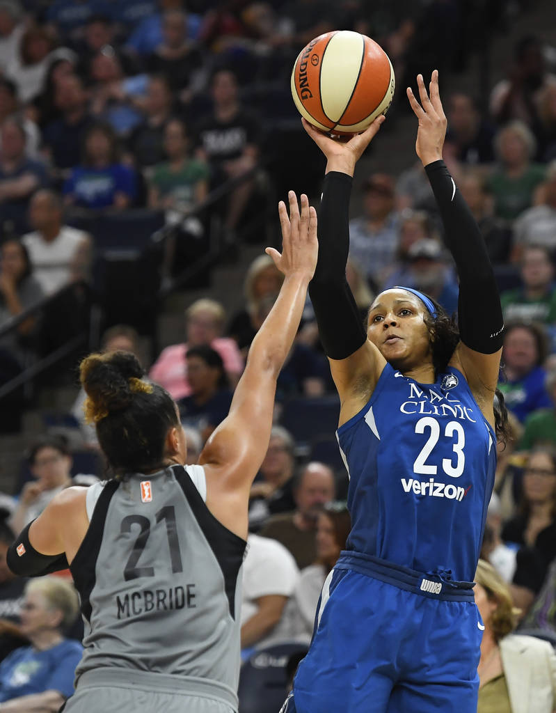 Minnesota Lynx forward Maya Moore (23) shoots a 3-point attempt over Las Vegas Aces guard Kayla McBride (21) during the first half of a WNBA basketball game Friday, July 13, 2018, in Minneapolis. ...