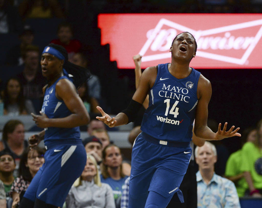 Minnesota Lynx forward Temi Fagbenle (14) reacts after her team was called for a shooting foul in the first quarter of a WNBA basketball game against the Las Vegas Aces in Minneapolis, Friday, Jul ...