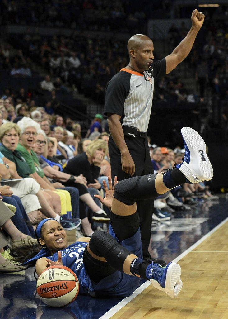 Minnesota Lynx forward Maya Moore falls out of bounds while chasing the ball, which was ruled last touched by the Las Vegas Aces during the second half of a WNBA basketball game Friday, July 13, 2 ...