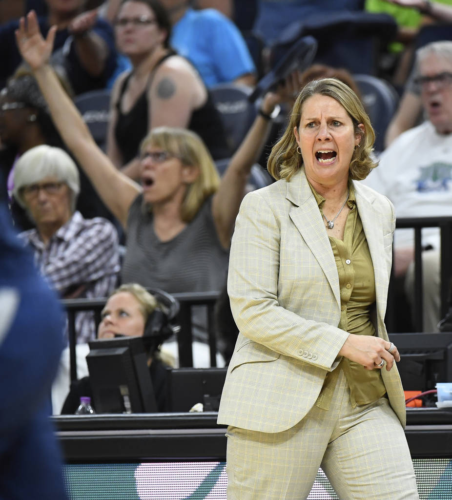 Minnesota Lynx head coach Cheryl Reeve argues against an offensive foul call ruled against guard Tanisha Wright in the second half of a WNBA basketball game against the Las Vegas Aces in Minneapol ...