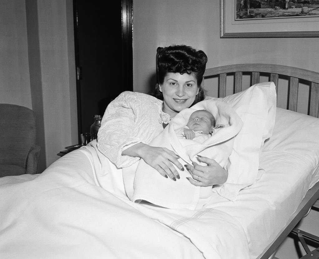In this Jan. 10, 1944 file photo, Nancy Sinatra holds her newborn son, Frank, at Margaret Hague Maternity Hospital in Jersey City, N.J. (AP Photo/Murray Becker, File)