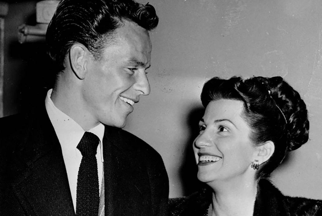 In this Oct. 23, 1946 file photo, singer Frank Sinatra and his wife Nancy smile broadly as they leave a Hollywood night club following a surprise meeting. (AP Photo/File)