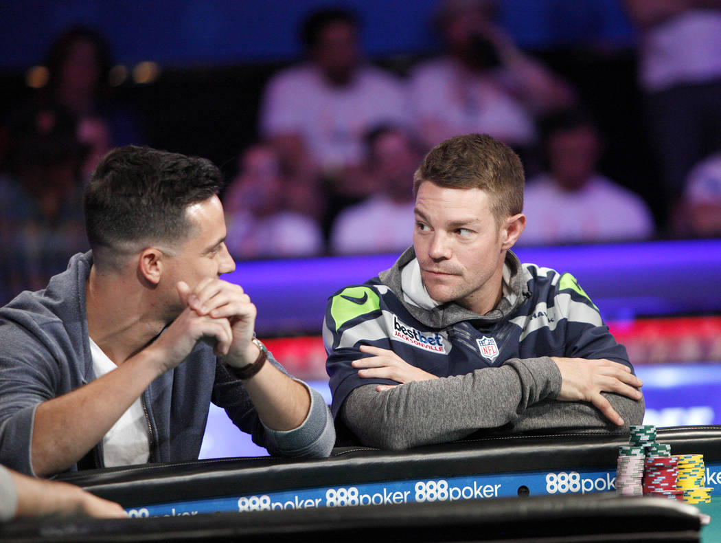 Alexander Lynskey, left, talks to Tony Miles, right, during the eighth day of the World Series of Poker tournament at the Rio Convention Center in Las Vegas, Thursday, July 12, 2018. Rachel Aston ...