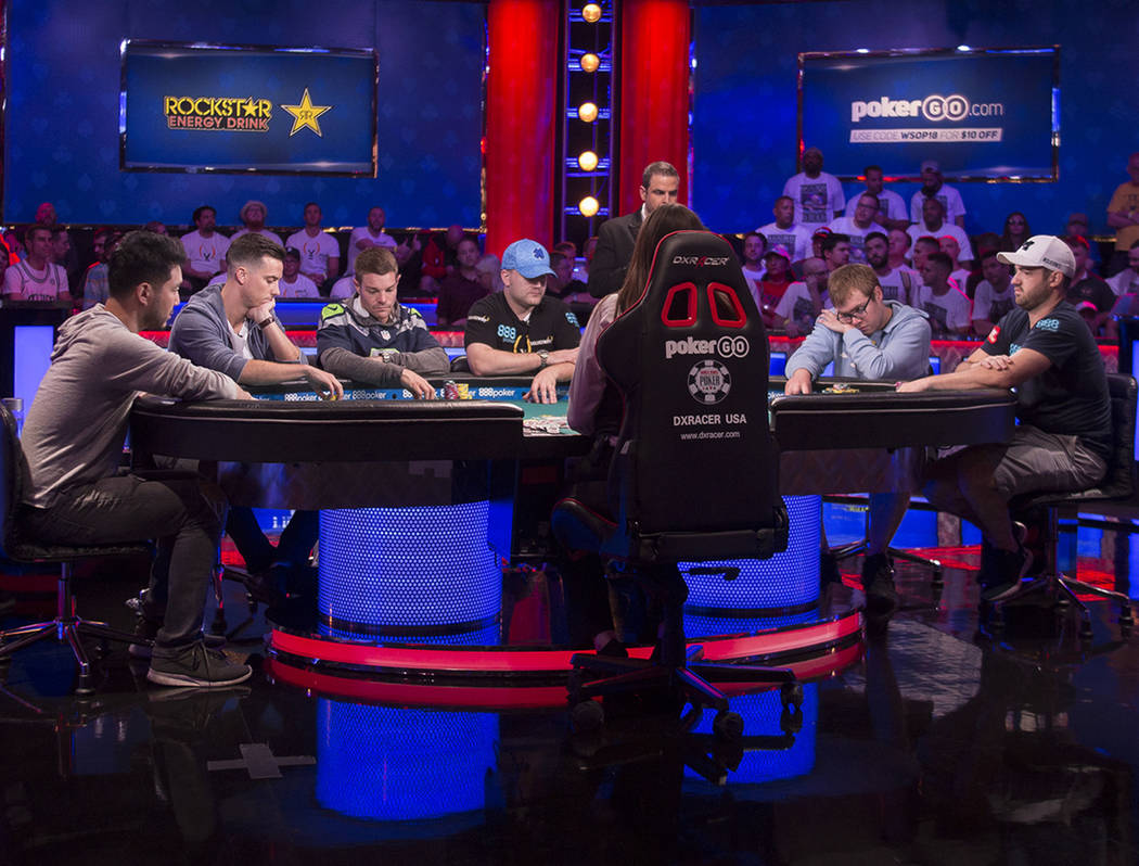 Seven players remain during the eighth day of the World Series of Poker tournament at the Rio Convention Center in Las Vegas, Thursday, July 12, 2018. From left, John Cynn, Alexander Lynskey, Tony ...