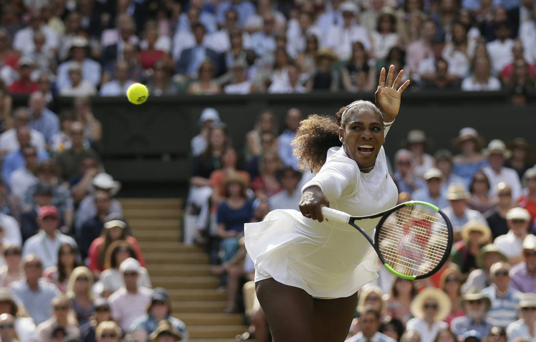 Serena Williams of the United States returns the ball to Germany's Julia Gorges during their women's singles semifinals match at the Wimbledon Tennis Championships, in London, Thursday July 12, 20 ...