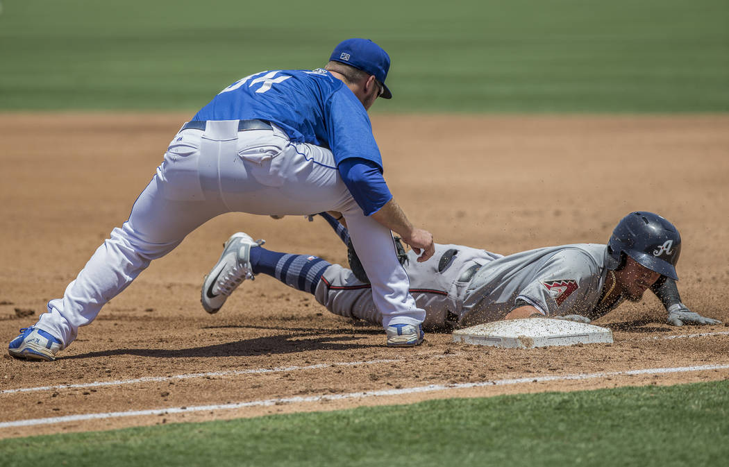 51s first baseman Peter Alonso (34) applies a tag during Las Vegas' home matchup with the Reno Aces on Sunday, June 24, 2018, at Cashman Field, in Las Vegas. Benjamin Hager Las Vegas Review-Journa ...