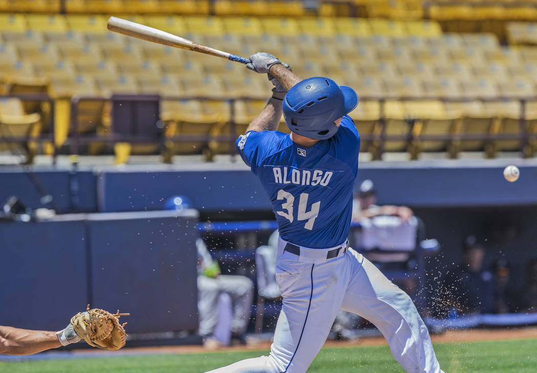 51s first baseman Peter Alonso (34) hits a ball down the third base line during Las Vegas' home matchup with the Reno Aces on Sunday, June 24, 2018, at Cashman Field, in Las Vegas. Benjamin Hager ...
