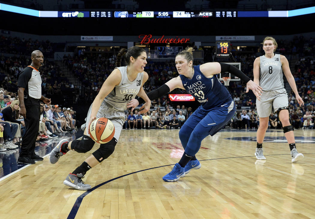 Las Vegas Aces guard Kelsey Plum drives against Minnesota Lynx guard Lindsay Whalen (13) during the second half of a WNBA basketball game Friday, July 13, 2018, in Minneapolis. (Aaron Lavinsky/Sta ...