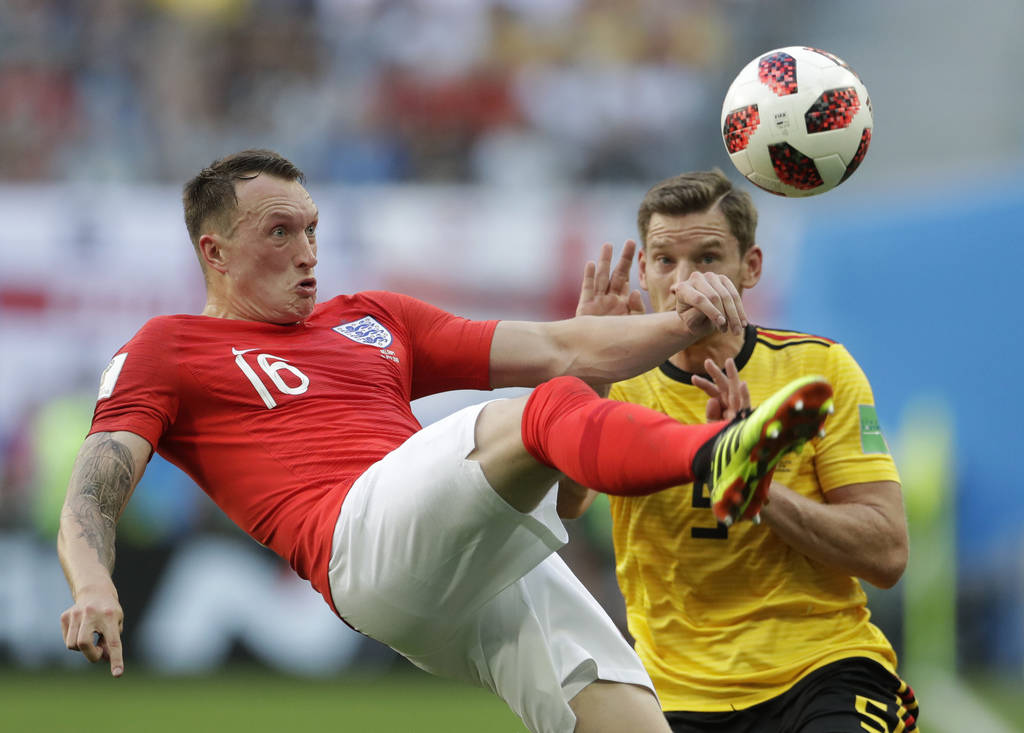 England's Phil Jones left controls a ball in front of Belgium's Jan Vertonghen during the third place match between England and Belgium at the 2018 soccer World Cup in the St. Petersburg Stadium i ...