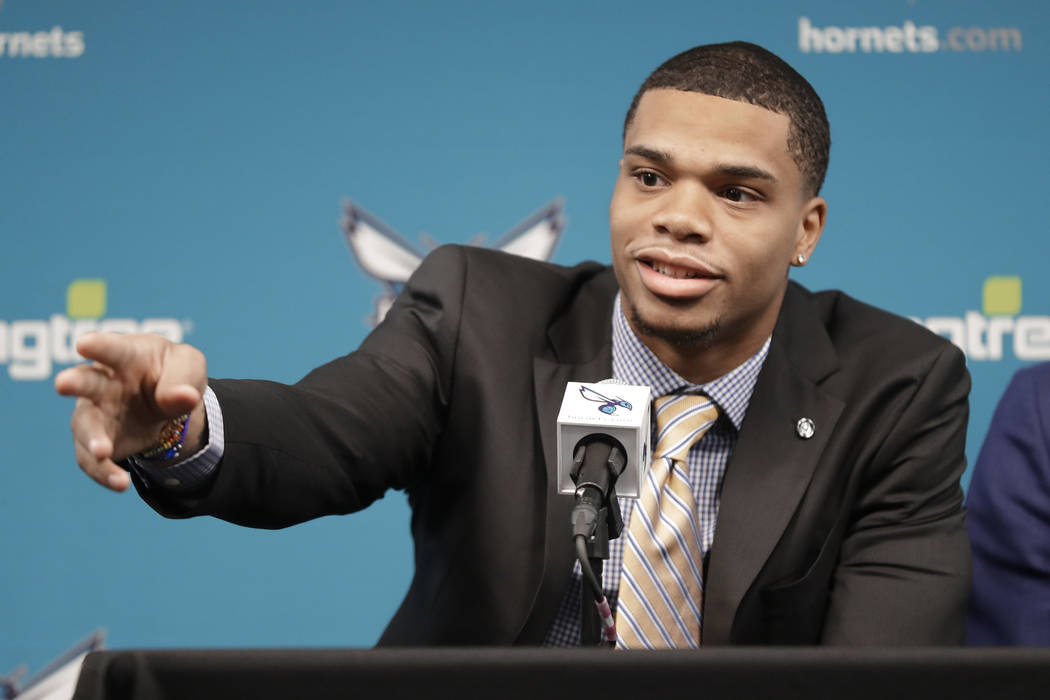 Charlotte Hornets draft pick Miles Bridges points out family members during a news conference for the NBA basketball team in Charlotte, N.C., Friday, June 22, 2018. (AP Photo/Chuck Burton)