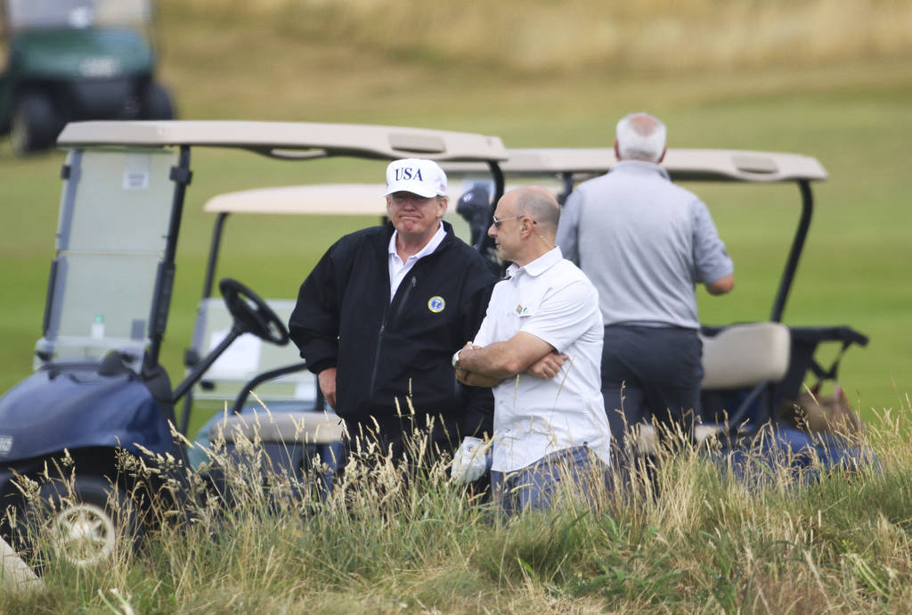 U.S. President Donald Trump waits on the 4th tee at Turnberry golf course, Scotland, Saturday, July 14, 2018. U.S. (AP Photo/Peter Morrison)