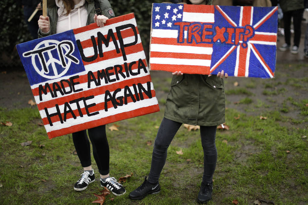 Demonstrators hold placards as they take part in a protest outside the U.S. embassy in London in February 2017.(AP Photo/Matt Dunham, file)