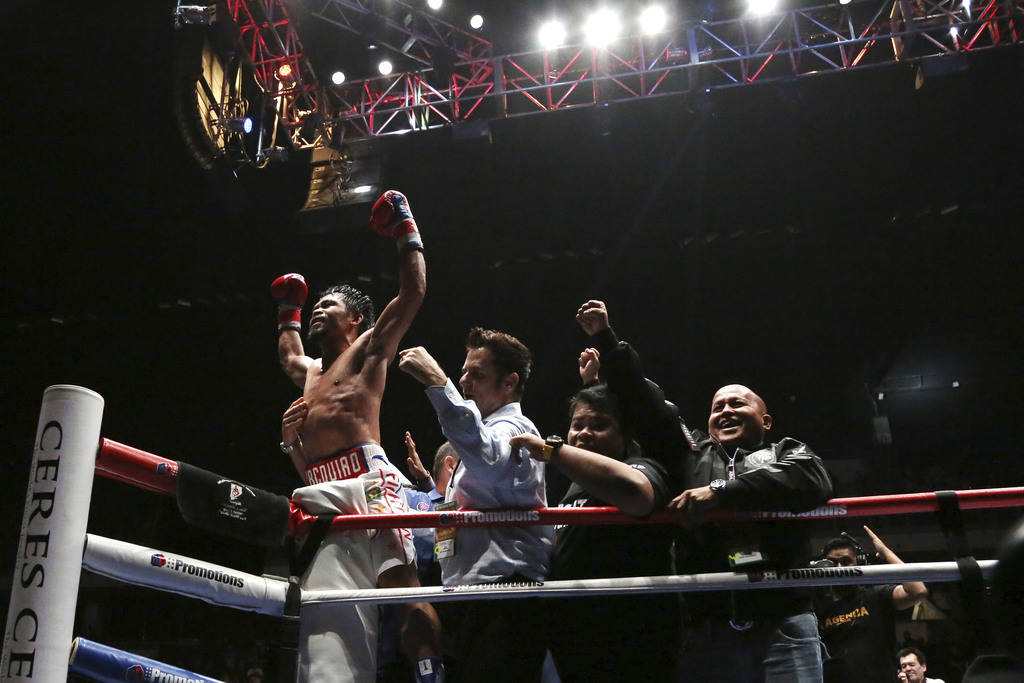 Philippines boxer Manny Pacquiao celebrates after defeating Argentina Lucas Matthysse during their WBA World welterweight title bout in Kuala Lumpur, Malaysia, Sunday, July 15, 2018. Pacquiao won ...