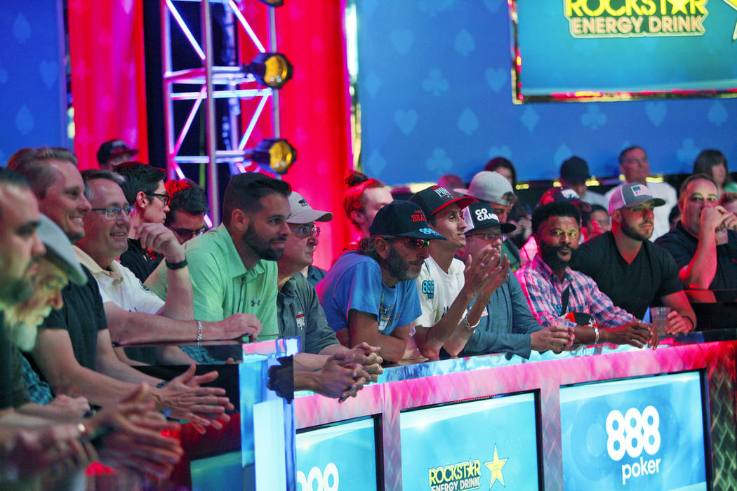 A large crowd watches the remaining three players Michael Dyer, John Cynn, and Tony Miles on day three at the World Series of Poker tournament of the main event final table at the Rio Convention C ...