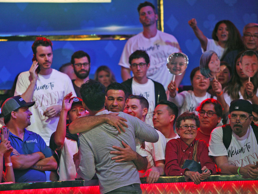 John Cynn hugs a supporter on day three of the main event final table at the World Series of Poker tournament at the Rio Convention Center in Las Vegas, Saturday, July 14, 2018. Rachel Aston Las V ...