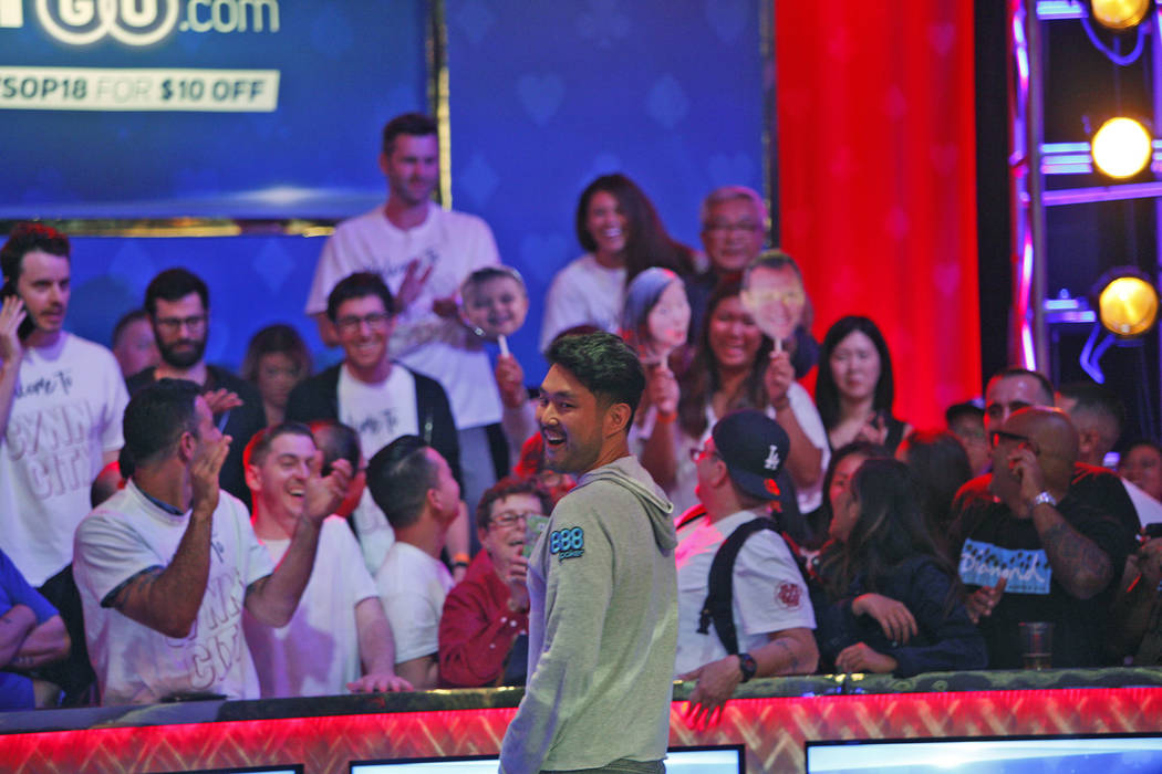 John Cynn laughs as his supporters cheer him on at day three of the main event final table at the World Series of Poker tournament at the Rio Convention Center in Las Vegas, Saturday, July 14, 201 ...