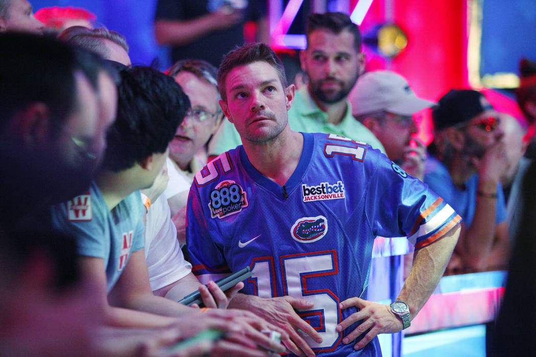 Tony Miles gets help from his coach on day three at the World Series of Poker tournament of the main event final table at the Rio Convention Center in Las Vegas, Saturday, July 14, 2018. Rachel As ...