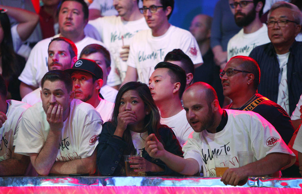 John Cynn's supporters nervously wait for the call on day three of the main event final table at the World Series of Poker tournament at the Rio Convention Center in Las Vegas, Saturday, July 14, ...