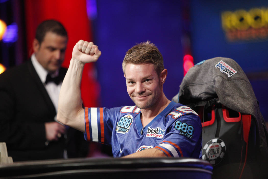 Tony Miles raises his fist after a good play on day three of the main event final table at the World Series of Poker tournament at the Rio Convention Center in Las Vegas, Saturday, July 14, 2018. ...