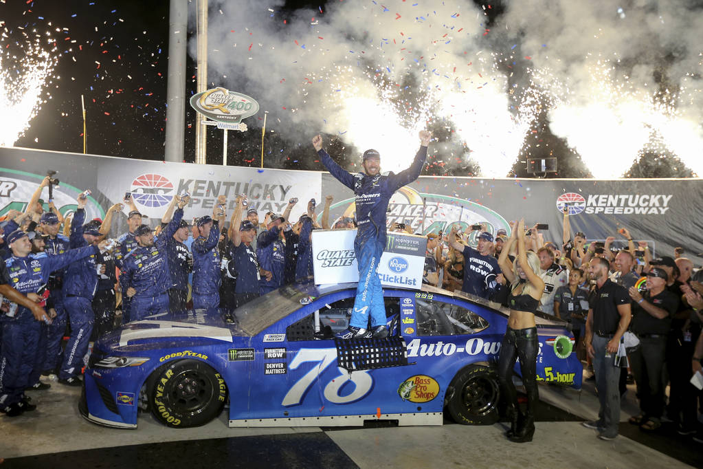 Martin Truex Jr. celebrates his win in the NASCAR Cup Series auto race Saturday, July 14, 2018, at Kentucky Speedway in Sparta, Ky. (Kareem Elgazzar/The Cincinnati Enquirer via AP)