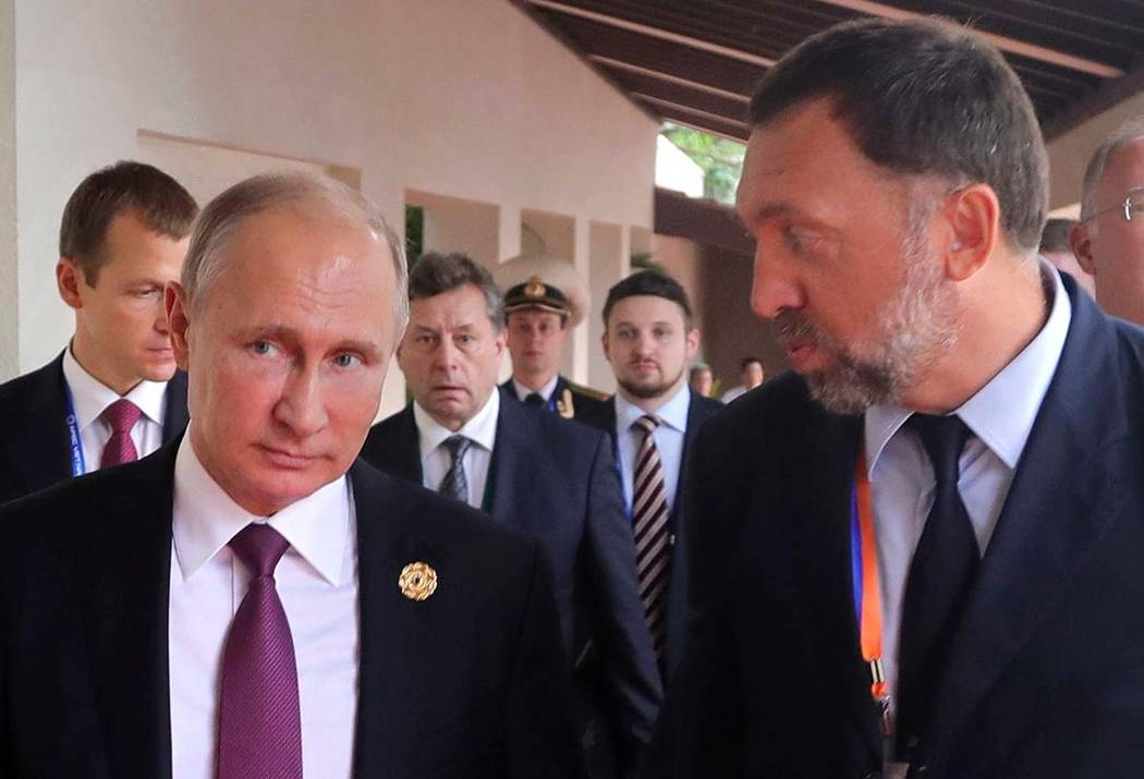 Russia's President Vladimir Putin, left, and Oleg Deripaska, right, attend the APEC Business Advisory Council dialogue in Danang, Vietnam, on Nov. 10, 2017. A U.S. lobbying firm sought to recruit ...