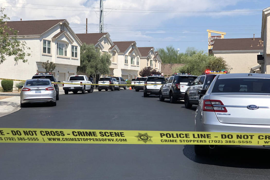 Las Vegas police investigate the death of a woman found unresponsive inside her home on the 4600 block of Dealers Choice Way on Saturday, July 14, 2018 in Las Vegas. (Rio Lacanlale/Las Vegas Revie ...